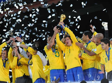 Brazilian players celebrate with the tro